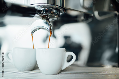 extraction of espresso from double open-end portafilter holder Canvas Print
