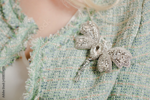 brooch made of beads and rhinestones in the shape of a dragonfly Fototapet