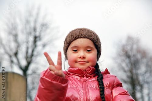 Obraz na plátně  Portrait of beautiful girl in the park