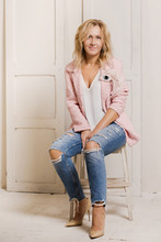A Woman In A Pink Jacket With ...