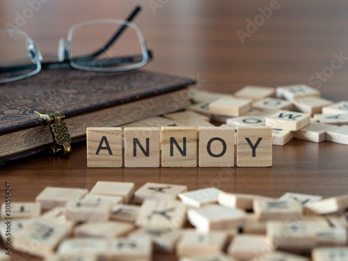 annoy the word or concept represented by wooden letter tiles Wallpaper Mural