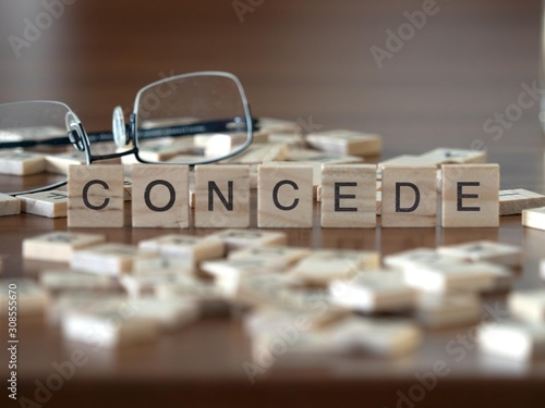 Vászonkép concede the word or concept represented by wooden letter tiles