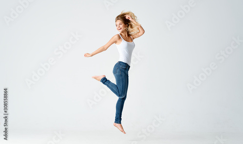 young woman jumping in the air Canvas Print