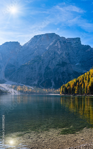 Cuadros en Lienzo  Sunshiny autumn peaceful alpine lake Braies or Pragser Wildsee