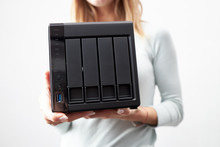 Girl Person Hold In Hands Portable Office Or Home Data Nas Server. Device For Backup Important Information. Copy Space. Four Hdd Slots And Usb Version 3 Plug.
