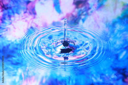 Fotografie, Tablou  Photo art, Water drop and circles on on the water, colorful background
