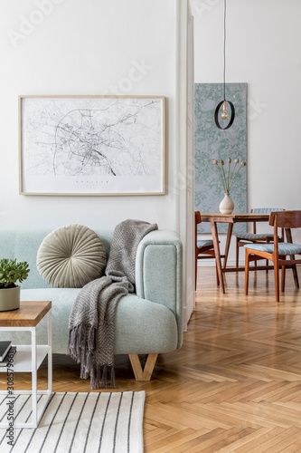 Stylish scandinavian living room with design mint sofa, furnitures, mock up poster map, plants and elegant personal accessories. Modern home decor. Open space with dining room. Template Ready to use.  - 308579661