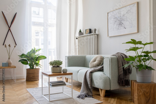 Carta da parati Stylish scandinavian living room with design mint sofa, furnitures, mock up poster map, plants and elegant personal accessories