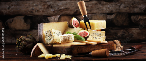 Fototapeta Different sorts of cheese. Cheese platter with different cheese and spice obraz