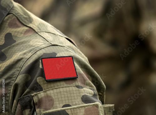 Red flag on military uniform Canvas Print