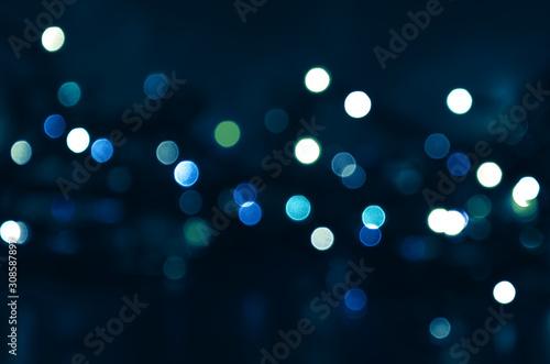 Obraz Dark blue background with blue and green bokeh lights - fototapety do salonu
