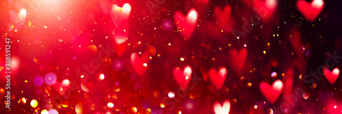 Valentine's Day red Background. Holiday Blinking Abstract Valentine Backdrop with Glowing Hearts. Heart Shape Bokeh. Love concept. Valentines art vivid design. Romantic banner - 308591247