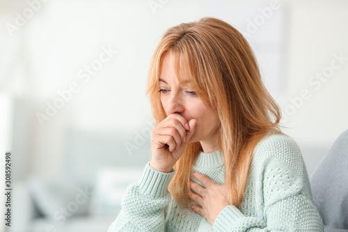 Stampa su Tela Beautiful mature woman ill with flu at home