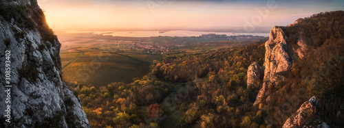 Fototapeta Colorful Autumn Sunset over Vineyards and Forest as Seen from Rocky Hill in Palava Protected Area near Mikulov in South Moravia, Czech Republic obraz
