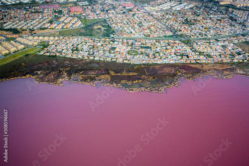 Aerial above a pink lake in Spain - 308596667
