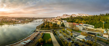 Aerial Panoramic Sunset View Of Coimbra Portugal With The Ancient University , Mondego River, Santa Clara, Isabel, Pedestrian Bridge