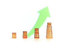 End Of Financial Year Concept With Positive Quarterly Report. Four Stacks Of Golden Coins With Size Increasing From Left To Right And An Upwards Green Arrow In The Background.