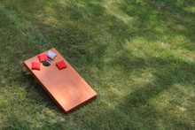 High Angle View Of Bean Bag Toss Corn Hole Game Red Bags And Wood Platform