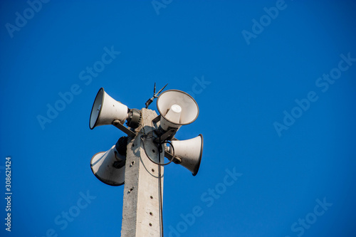 Speaker broadcasting on a 360 degree concrete pole Canvas Print