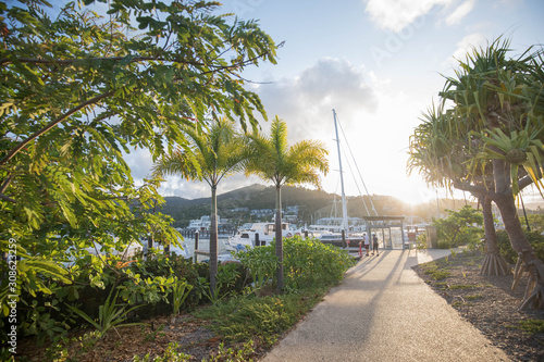 Footpath along Port of Airlie Marina in Airlie Beach Queensland as the sun sets Canvas Print