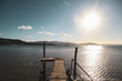 Late afternoon view of small rustic wooden jetty at Mandalay off Airlie Beach when the tide is out