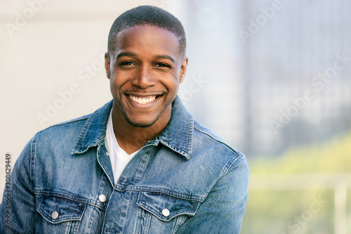 Fototapeta Close up head shot of a handsome commercial african american model with perfect