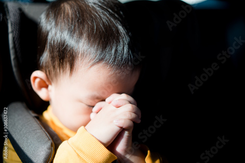 Little toddler boy praying and worship to GOD in his car for safe trip Canvas Print