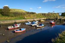 Fishing Boats At Low Tide At T...