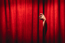 The Hand On The Red Curtain Ba...