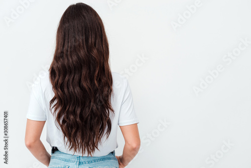 Photo Back view of standing young beautiful brunette woman