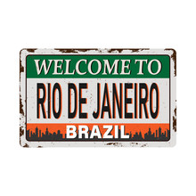Touristic Retro Vintage Greeting Sign, Typographical Background Welcome To Rio De Janeiro , Vector Design. Texture Effects Can Be Easily Turned Off.