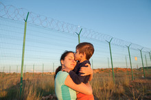 Release Of Prisoners On State Border Happy Child Kissing Mother After Refugee Family Reunion