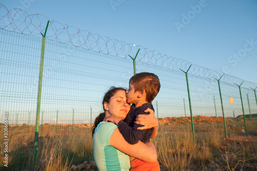 Valokuva release of prisoners on state border happy child kissing mother after refugee fa