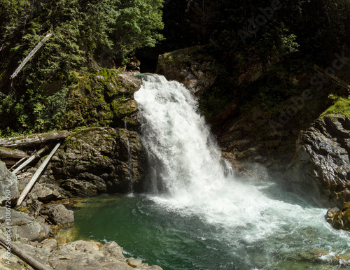 Thundering emerald colored punchbowl waterfall North Fork Sauk River Falls of the north cascades in a rocky gorge off Mountain Loop Highway in Darrington Snohomish county Washington State  Wall mural