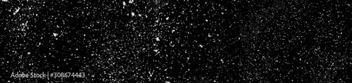 Obraz na płótnie Falling white snow isolated on a black background.