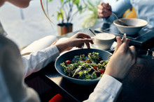 Woman Eating Salad In Restaurant