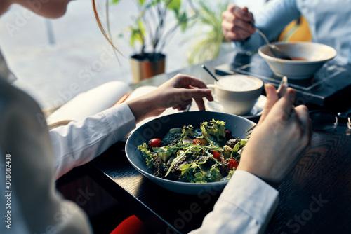Fototapeta woman eating salad in restaurant obraz