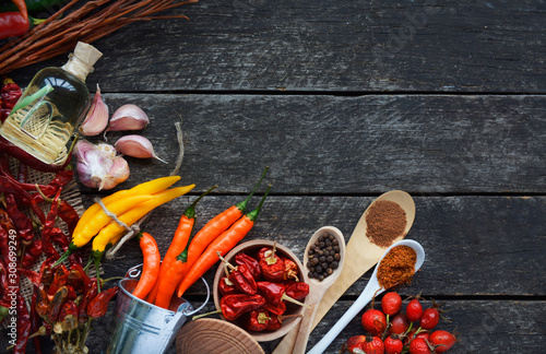 chili pepper, various spices on old wooden - top view Wallpaper Mural