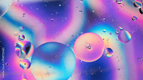 Obraz Oil drops in water. Abstract psychedelic pattern image rainbow colored. Abstract background with colorful gradient colors. DOF - fototapety do salonu