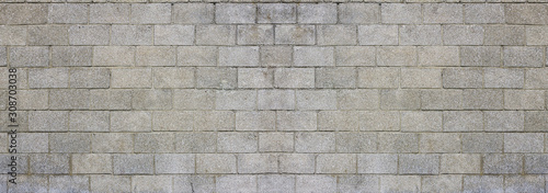 Photo Large and dirty cinderblocks wall background or texture