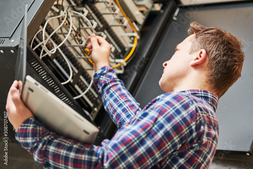 network engineer admin works with server equipment Fototapeta