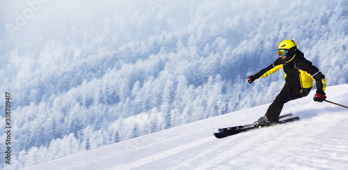 Skier in winter mountains