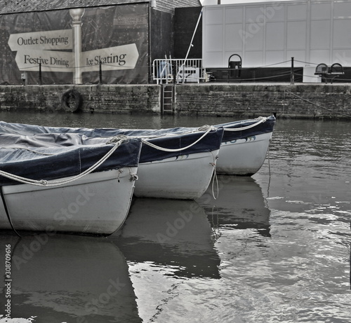 A desaturated image of canal boats tied up on the canal at the Gloucester Quays  in Gloucester, England Slika na platnu