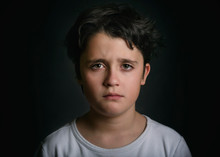 Portrait Of Sad Child