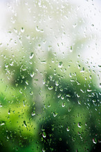 Summer Rain Leaves A Drop On The Window