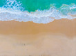 White sand beach turquoise sea wave aerial view copy space