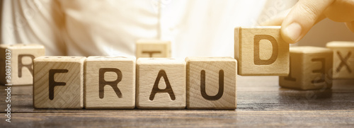 Fotografía Wooden blocks with the word Fraud and man