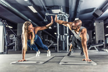 Sport Couple Doing Plank Exerc...