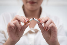 Woman Breaking Cigarette To Qu...