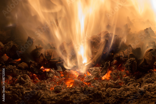 Canvastavla Texture embers closeup. Embers after a fire.
